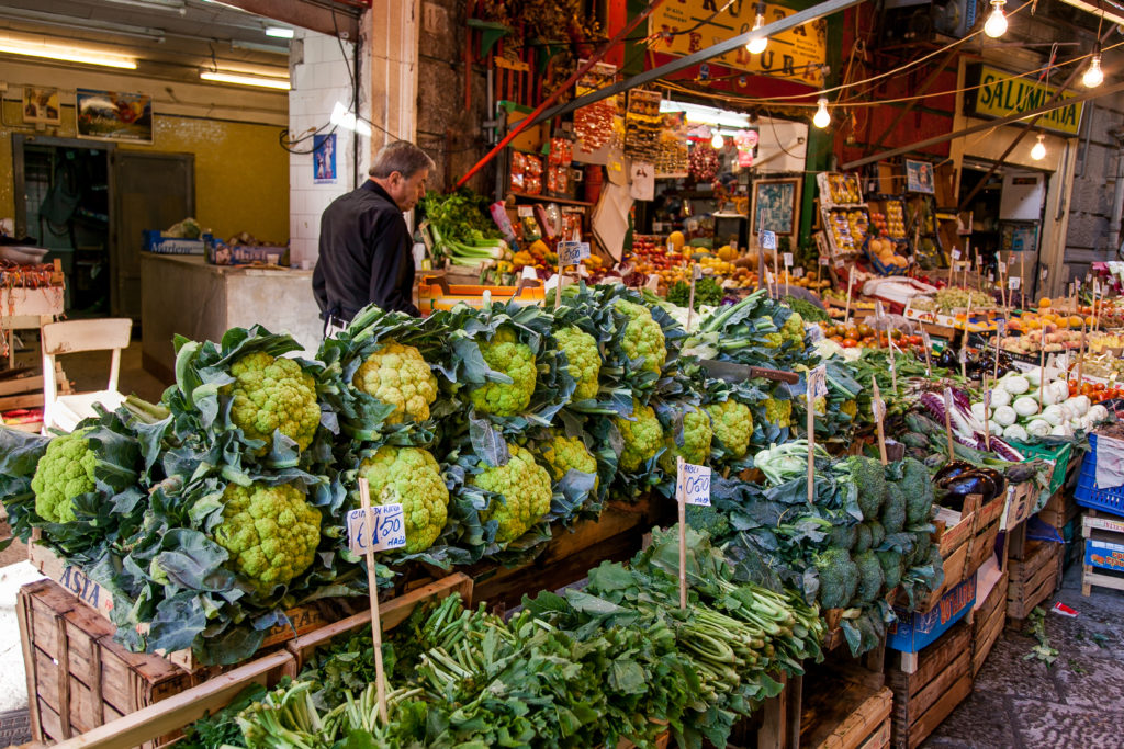 PALERMO, ITALY - October 14, 2009: Fresh fish, seafood, vegetables and fruit at a Vucciria market in Palermo, Sicily