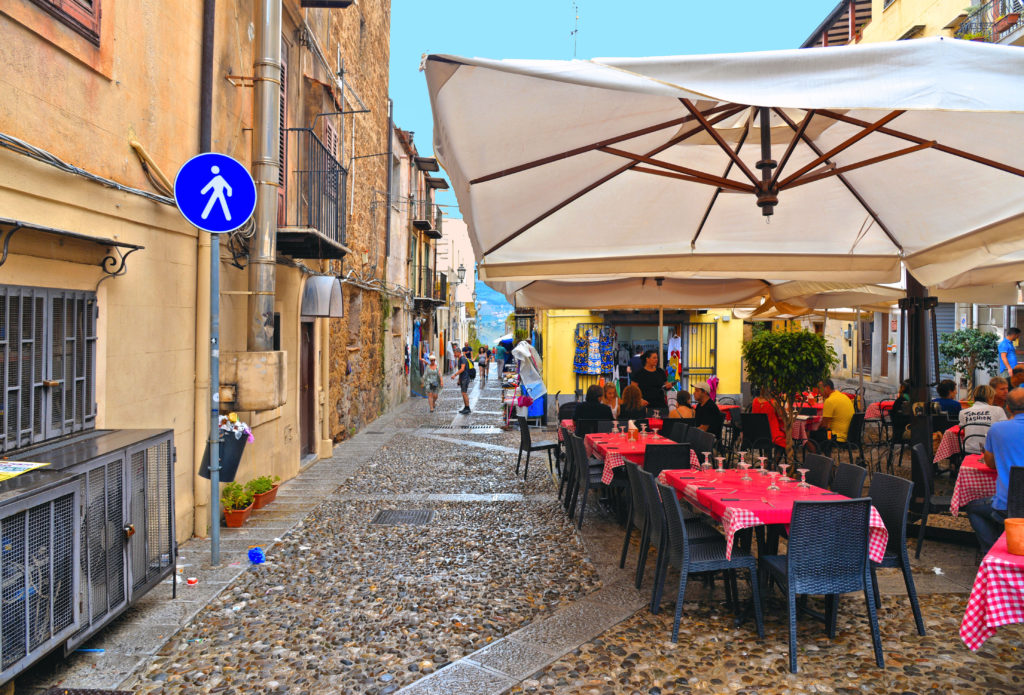 22.08.2018.  People drinking and relaxing in Street restaurants and bar cafe in pedestrian street in historical center of Monreale Palermo, Sicily island in Italy