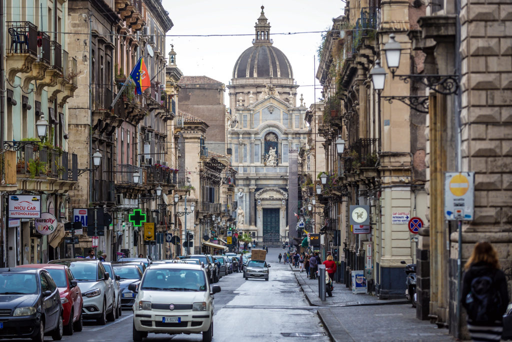 Catania, Italy - May 13, 2019: St Agatha cathedral in Catania city on east coast of Sicily, view from Garibaldi street