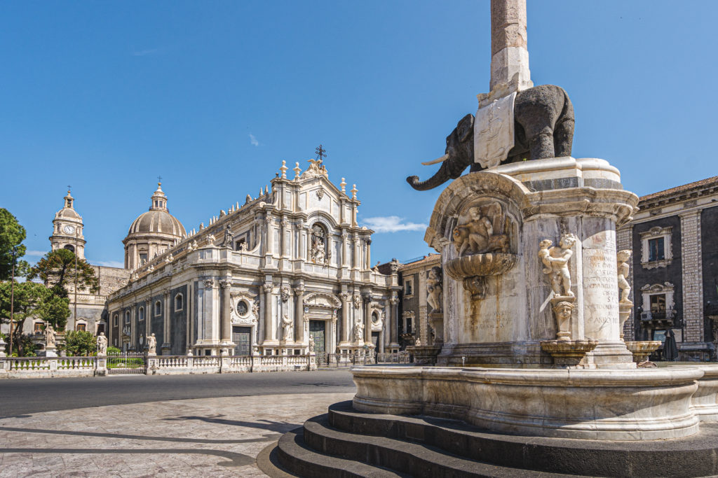 Catania, Sicily (Italy). Dome the fountain elephant (1737) and the Cathedral of Saint Agatha.