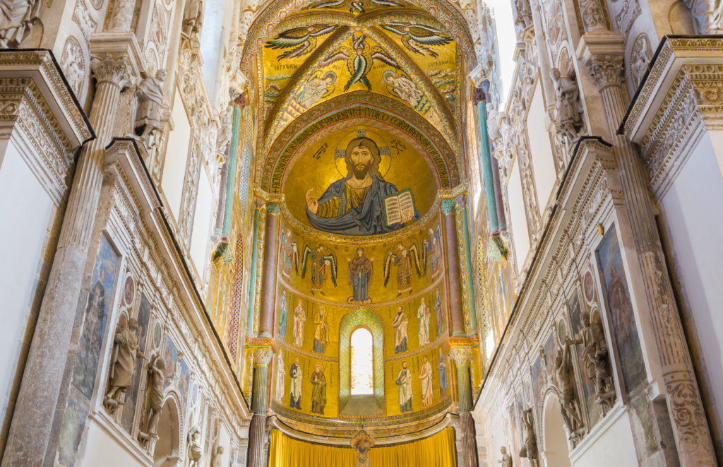 CEFALU, ITALY - SEPTEMBER 11, 2015: Interior of the Cathedral-Basilica of Cefalu (Duomo di Cefalu). Main nave with the mosaic of Christ Pantocrator in Byzantine style. Cefalu, Sicily, Italy.