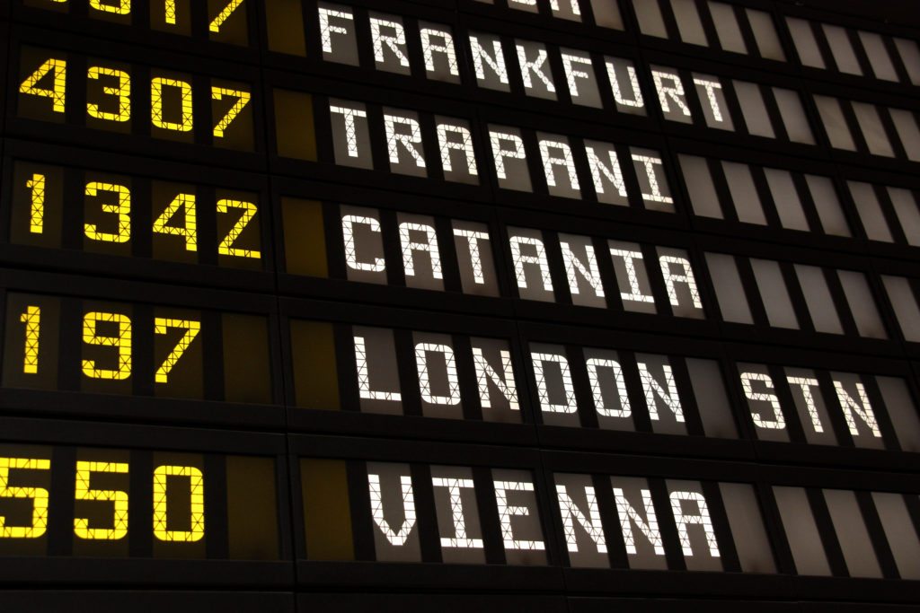 Departure board at an airport in Italy. Flights to Frankfurt, Trapani, Catania, London and Vienna
