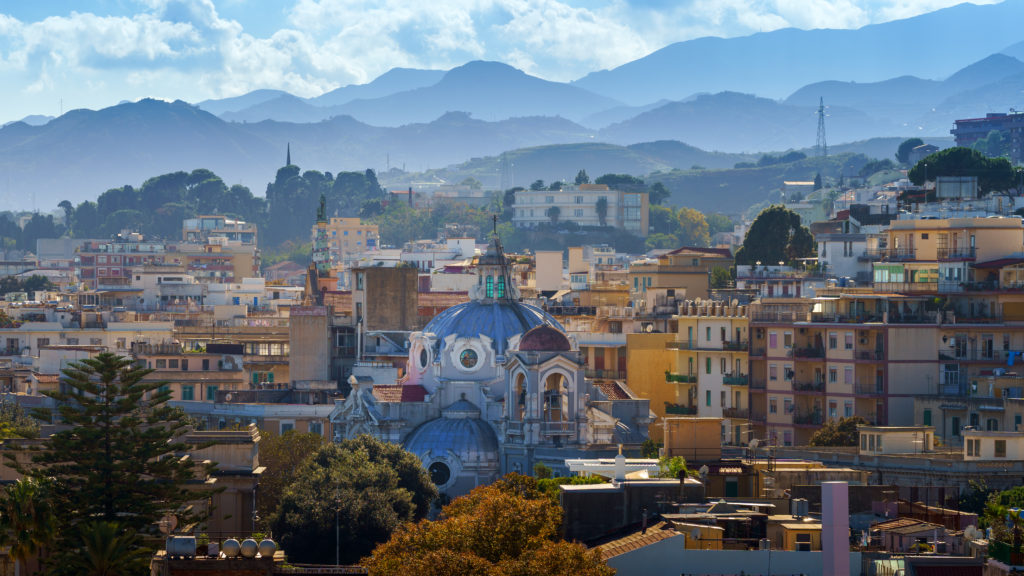 MESSINA, ITALY - NOVEMBER 06, 2018 - The church Sanctuary of Our Lady of Mount Carmel or Chiesa del Carmine in Sicily with the city panorama