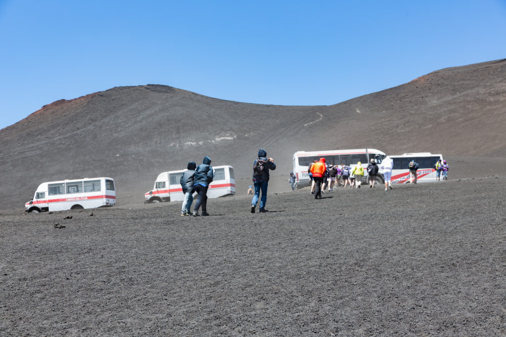 MOUNT ETNA,  ITALY - MAY 23: Landrovers ands tourists visiting the vulcano of Mount Etna on May 23, 2016 at the island Sicily, Italy