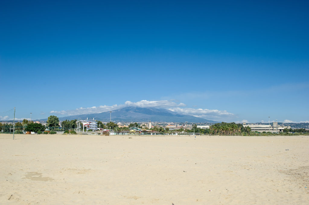 """Mount Etna view from """"La Playa"""" beach in Catania, Sicily"""