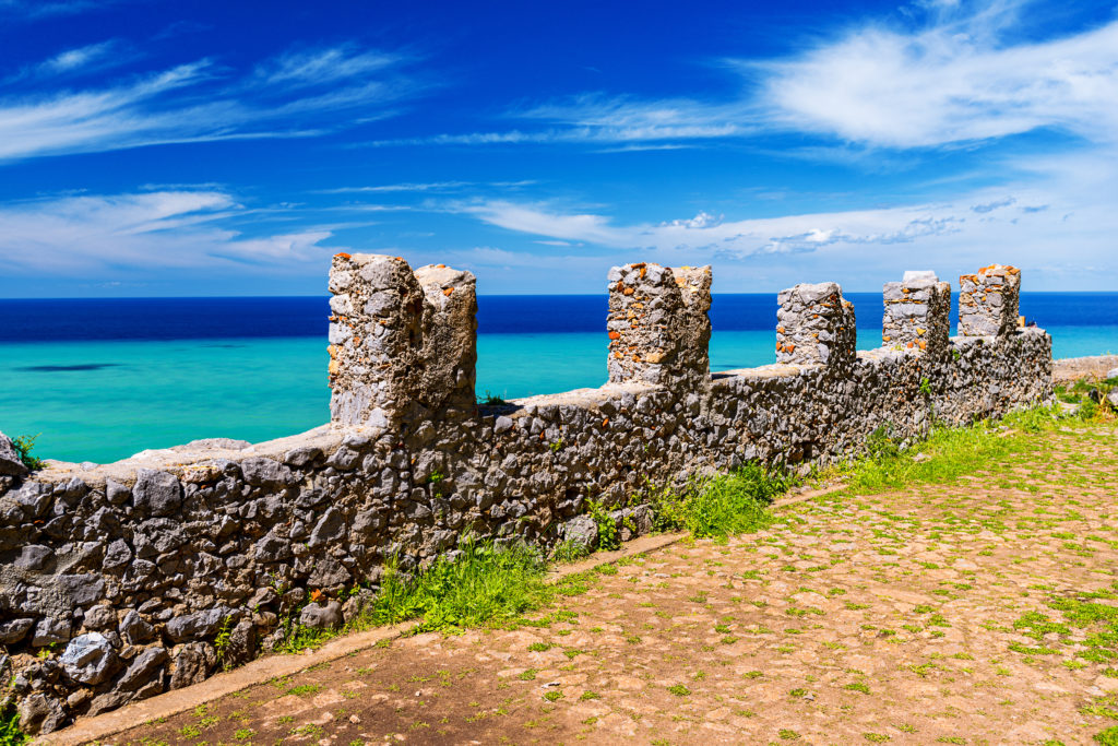 Ruins of ancient castle on the top of Cefalu Rock, large massif in Cefalu city on the shore of Tyrrhenian Sea on Sicily Island in Italy