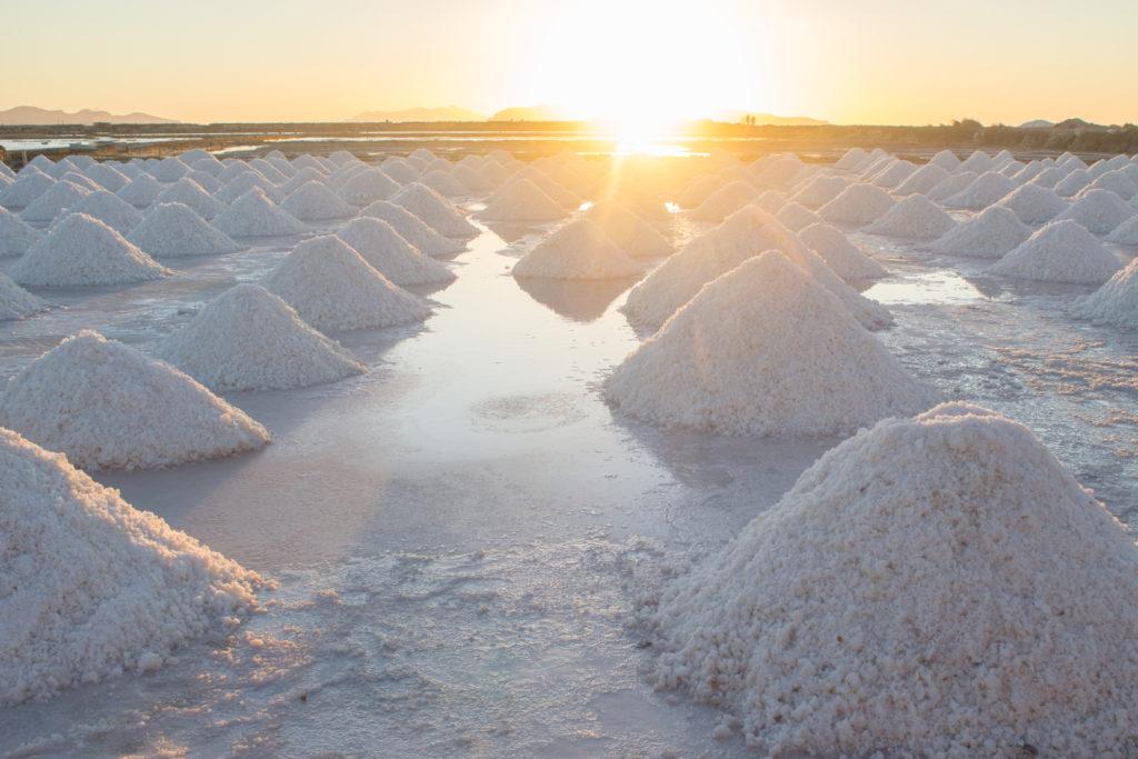 Sea salt mounds at salt marsh on sunset