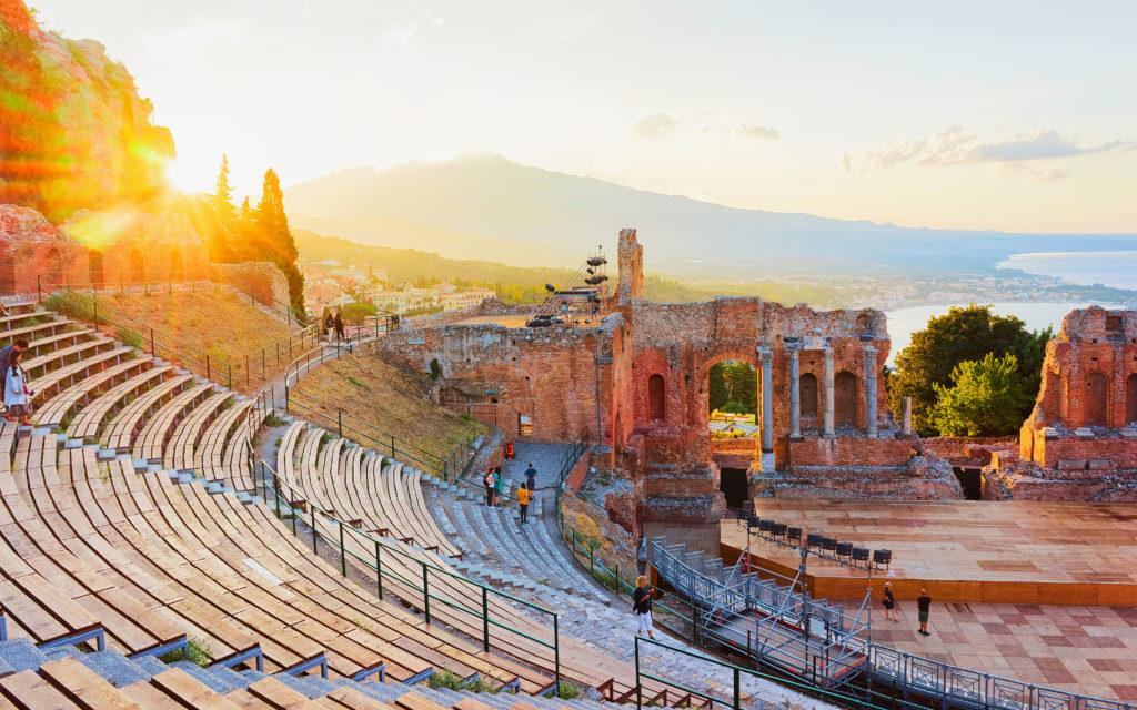Sunset at Greek theater of Taormina, Sicily, Italy. Travel
