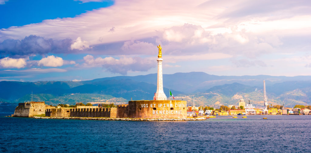 The Madonna della Lettera statue at the entrance to the harbour of Messina, Sicily, Italy. One of the famous landmarks of Sicily.