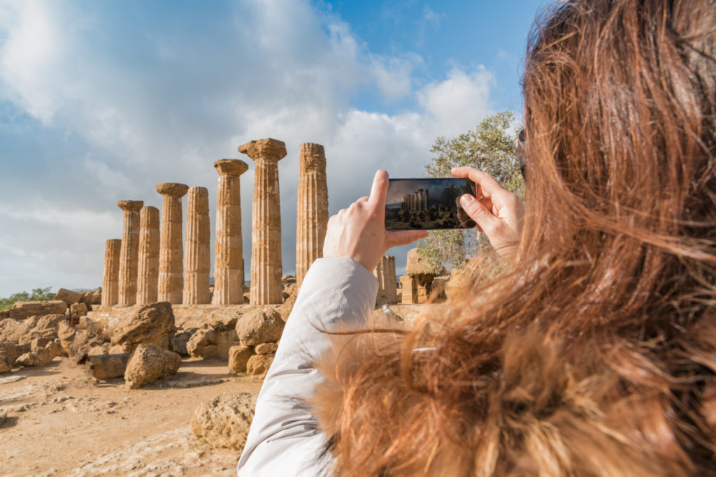 travel to Italy - Dorian columns of ancient Temple of Heracles (Tempio di eracle) in Valley of the Temples in Agrigento, Sicily
