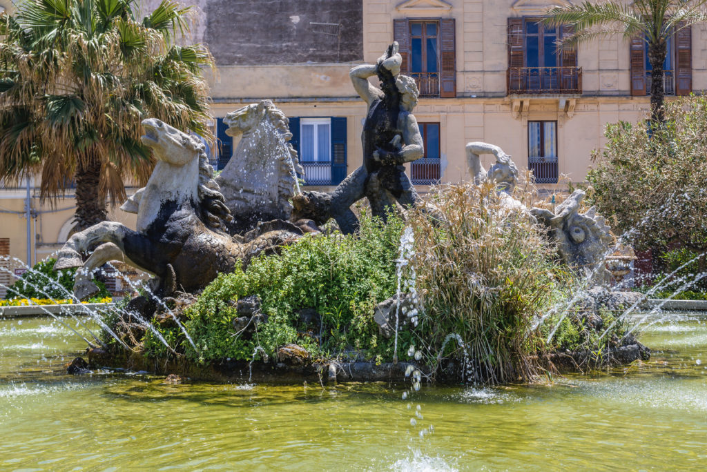 Triton Fountain located on Square of Victor Emmanuel in Trapani, capital of Trapani Province on Sicily Island in Italy