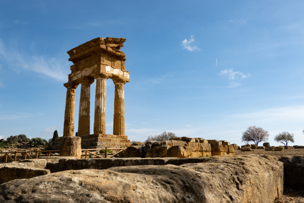 Wide-angle shot of Tempio di Castore e Polluce in Valley of the Temples (Valle dei Templi) near Agrigento, Italy