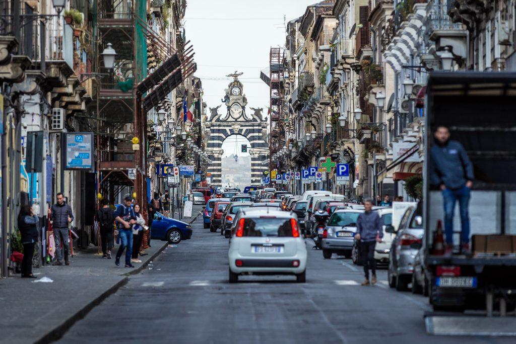 Catania, Italy - May 13, 2019: Garibaldi Gate in Catania city on east coast of Sicily, view from Garibaldi Street