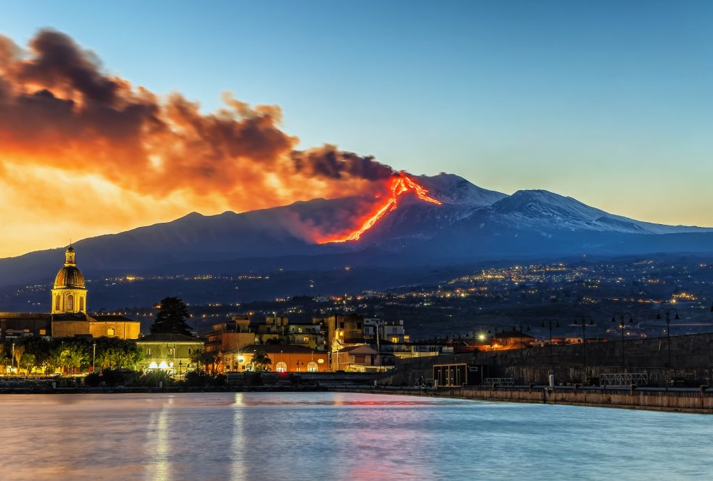 Panorama of the Ionian coast of Etna during the eruption of Etna