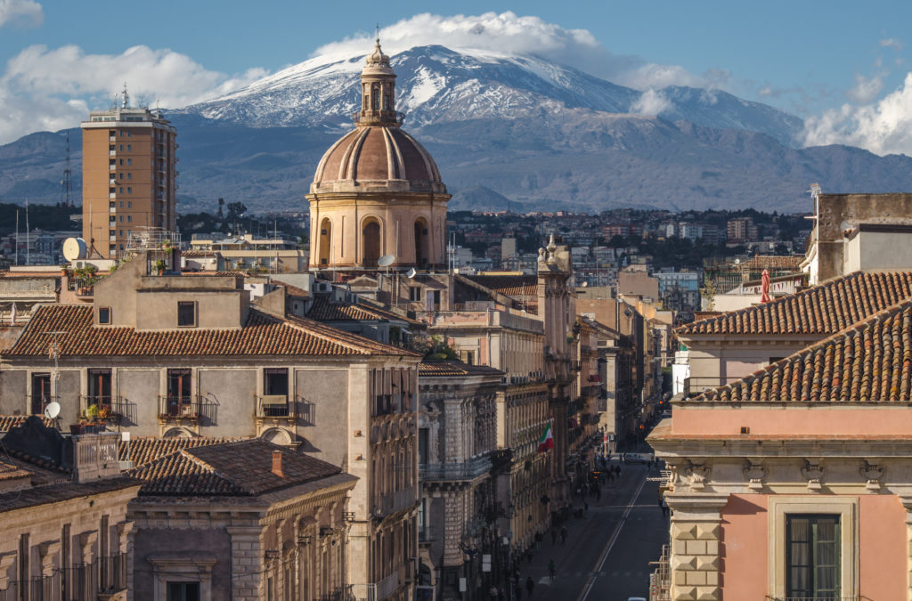 View on via Etnea in Catania. Dome of Catania and the main street with the background of volcano Etna, Sicily, Italy. Catania the UNESCO World Heritage.
