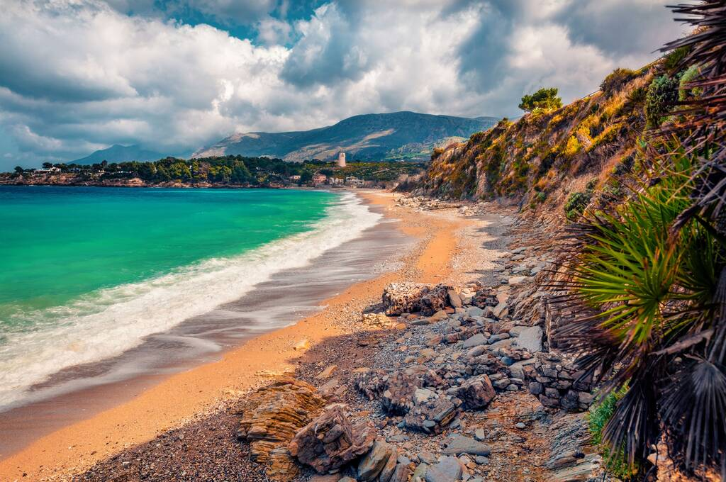 Beautiful marine scenery. Dramatic morning view of popular italian destination - Guidaloca beach, Scopello location, Sicily, Europe. Attractive summer seascape of Mediterranean sea, Italy.
