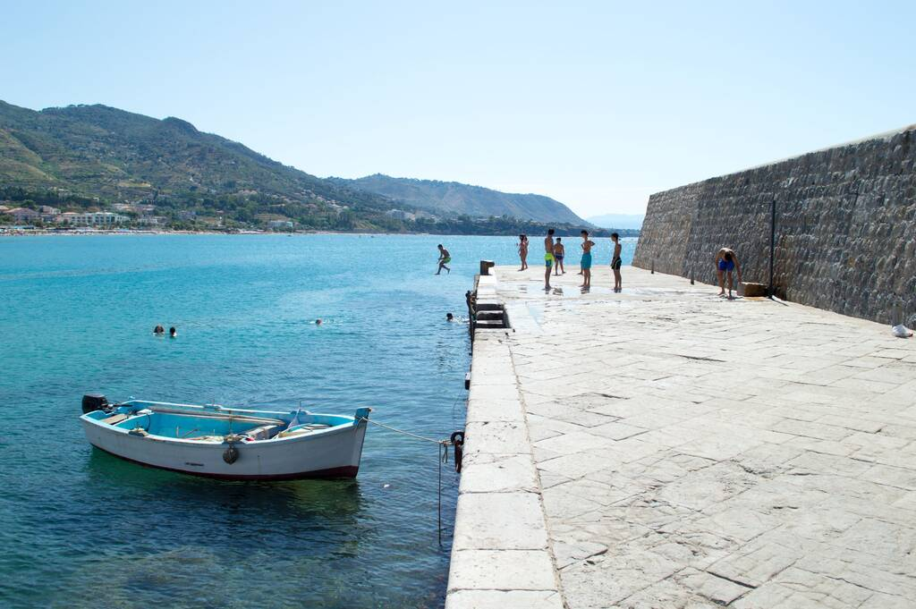 Cefalù, Sicily, Italy, july 2020. Daily summer scene at the beach - little harbour