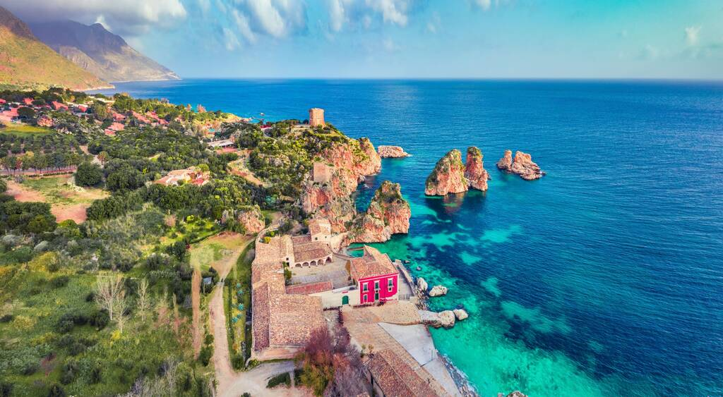 View from flying drone. Picturesque spring scene of Tonnara di Scopello. Colorful landscape of Sicily, Italy, Europe. Wonderful morning seascape of Mediterranean sea. Traveling concept background.