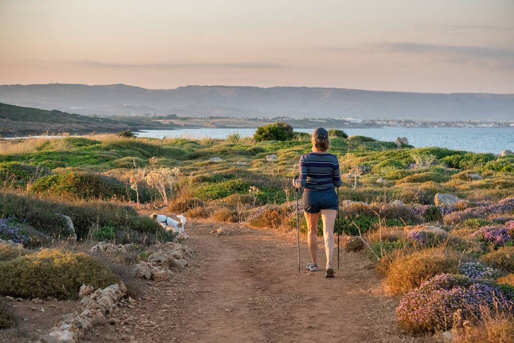woman trekking in calamosche beach -  Vendicari Oasis natural retreat